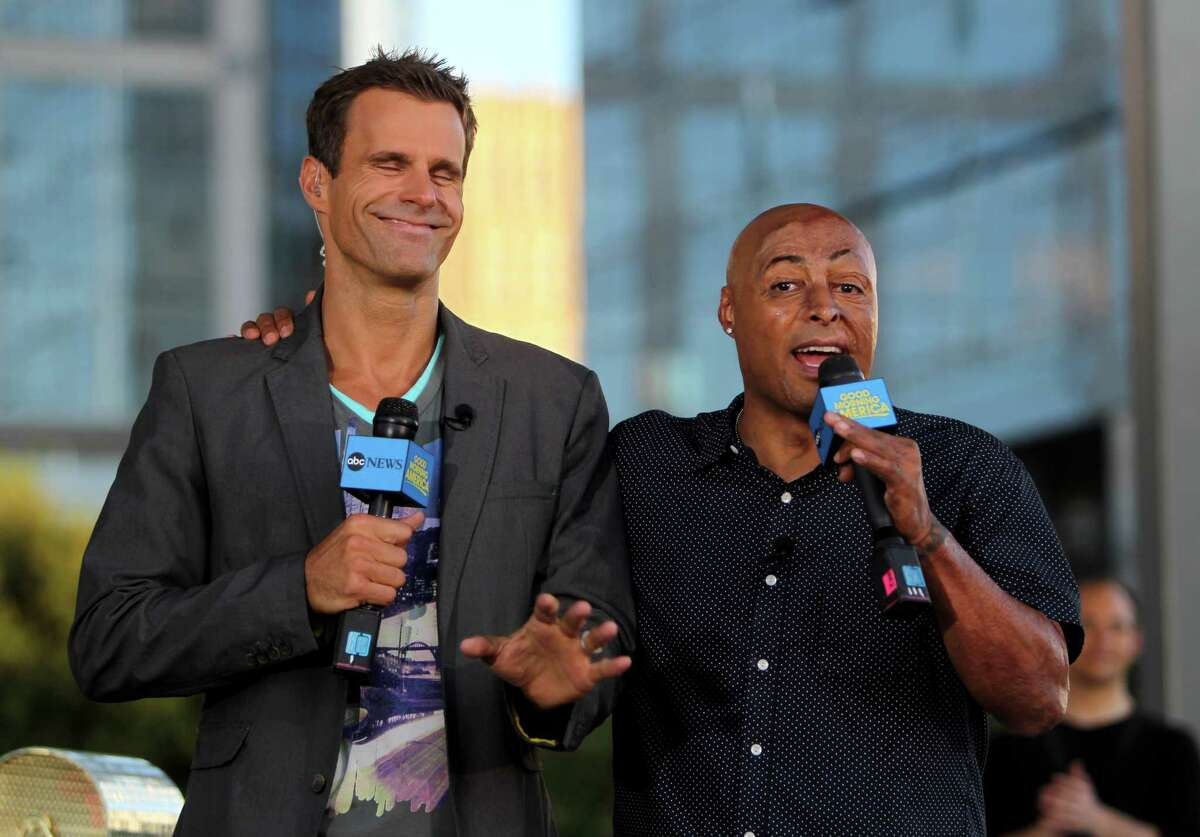 """Good Morning America's """"Shake It and Dance Mirror Ball Tour"""" judged by Cameron Mathison, left, and J.R. Martinez, both formerly on All My Children, at Discovery Green Wednesday, Sept. 10, 2014, in Houston, Texas. The winner of the dance off won two tickets to the """"Dancing With The Stars"""" season premiere in Los Angeles, California."""