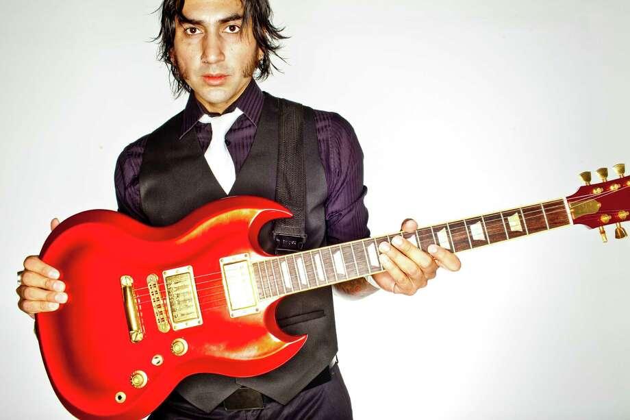 Musician Michael Flores, Dec. 15, 2011 in Houston. Photo: Eric Kayne, Freelance / © 2011 Eric Kayne