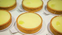 FOR CHRON 100 RESTAURANT REVIEW. DO NOT USE FOR ANYTHING ELSE WITHOUT A PHOTO EDITOR'S PERMISSION. THANKS.  Common Bond Cafe & Bakery's lemon tarts,  photographed, Friday, July 18, 2014, in Houston. ( Nick de la Torre )