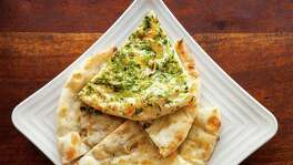 FOR CHRON 100 RESTAURANT REVIEW. DO NOT USE FOR ANYTHING ELSE WITHOUT A PHOTO EDITOR'S PERMISSION. THANKS.  Himalaya Restaurant & Catering's Naan, Garlic Naan on top. Photographed, Tuesday, August 5, 2014, in Houston. ( Nick de la Torre )
