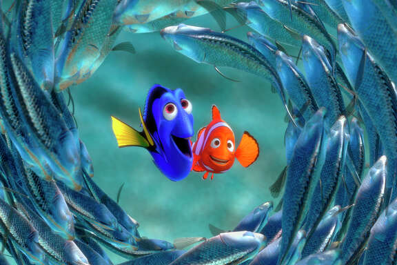 """** FILE ** Dory, center left, and Marlin are surrounded by a school of moonfish in this scene from The Walt Disney Co.'s animated film """"Finding Nemo,"""" in this undated promotional photo. Revenues increased 6.9 percent to $6.2 billion compared to $5.8 billion in the same quarter last year as """"Finding Nemo,"""" produced in conjunction with Pixar Animation Studios, set box office records. (AP Photo/Disney Enterprises Inc./Pixar Animation Studios)  HOUCHRON CAPTION (02/12/2004):  Talks broke off to renew Disney's valuable deal with Pixar, which had produced magical hits such as Toy Story (NOT PICTURED) and Finding Nemo.  HOUCHRON CAPTION (03/01/2004):  Finding Nemo won the Oscar for best animated feature film.  THE WINNERS.   HOUCHRON CAPTION  (12/31/2004) SECSTAR:  FISH FRIENDS: Dory and Marlin are surrounded by a school of moonfish in """"Finding Nemo."""