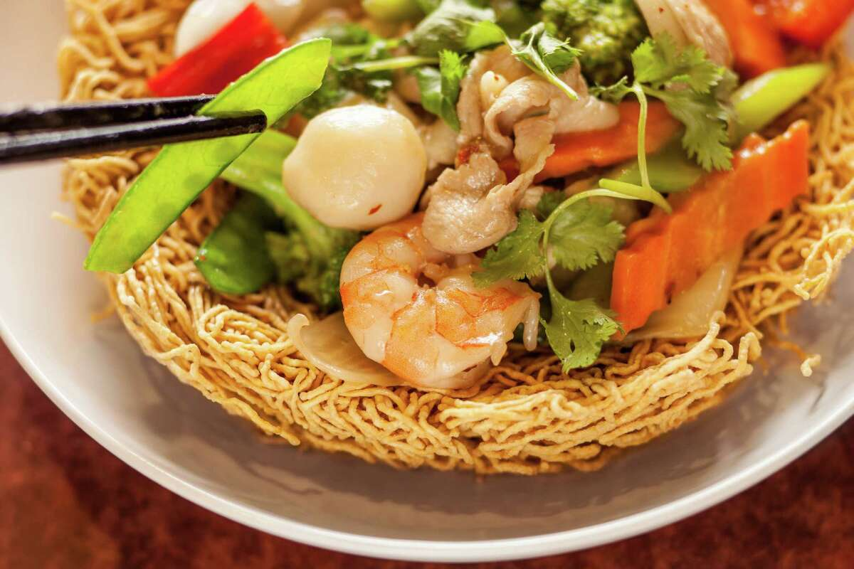 Interior of Huynh Restaurant Authentic Vietnamese Cuisine's Mi Xao Don Do Bien, crispy Egg noodle stir fried with seafood and mixed vegetable and 'birds nest noodles. Photographed, Monday, August 4, 2014, in Houston. ( Nick de la Torre )