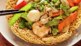 FOR CHRON 100 RESTAURANT REVIEW. DO NOT USE FOR ANYTHING ELSE WITHOUT A PHOTO EDITOR'S PERMISSION. THANKS.  Interior of Huynh Restaurant Authentic Vietnamese Cuisine's Mi Xao Don Do Bien, crispy Egg noodle stir fried with seafood and mixed vegetable and 'birds nest noodles. Photographed, Monday, August 4, 2014, in Houston. ( Nick de la Torre )