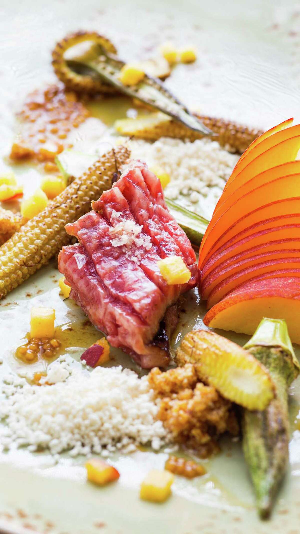 Kogashima A5 Kobe Beef, Texas Peaches, okra, corn, smoked peach and mostarda at Triniti.