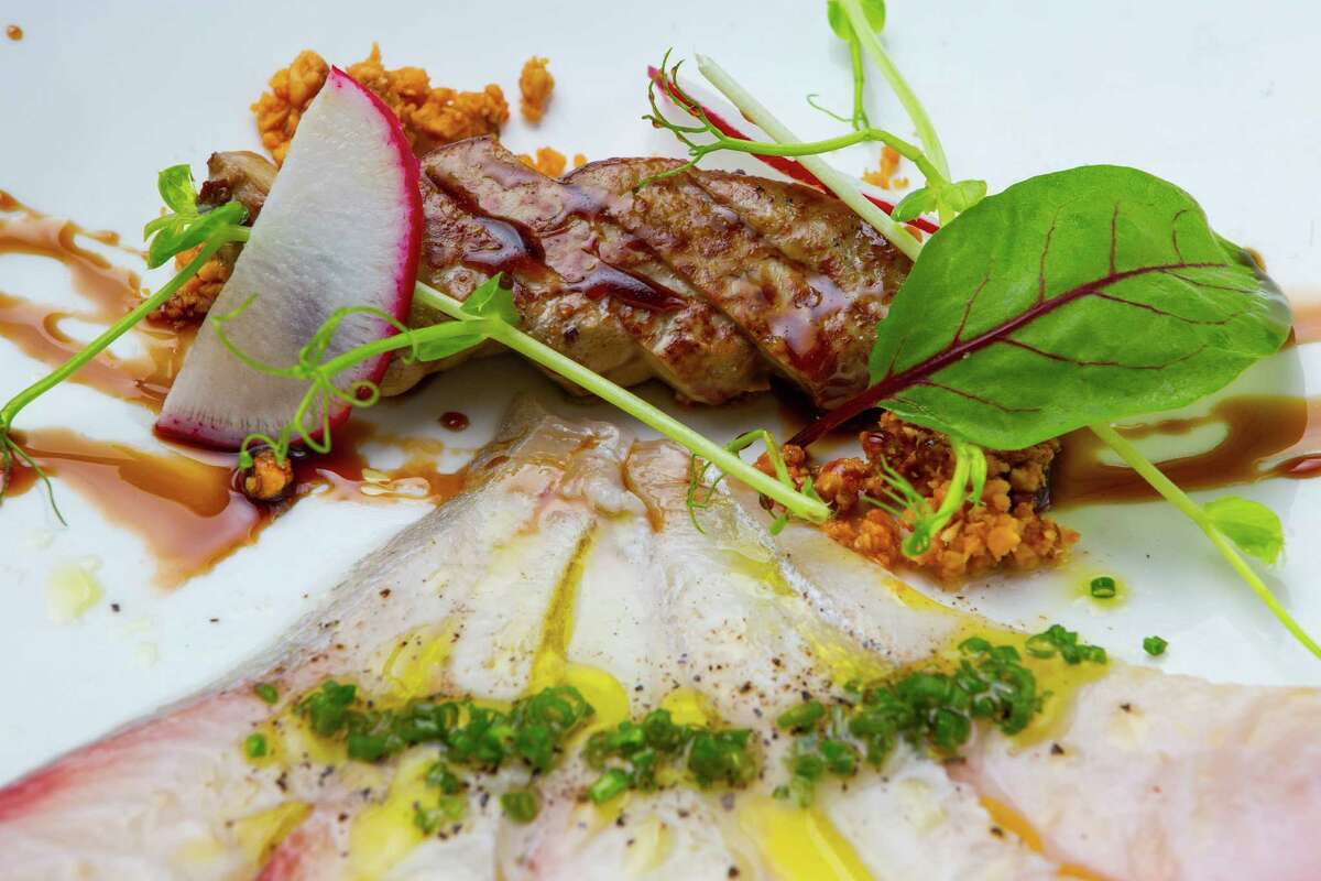 Kata Robata Sushi & Grill's Hawaiian Amber Jack sushimi with seared foix gras crushed hazel nuts. Photographed, Tuesday, August 5, 2014, in Houston. ( Nick de la Torre )