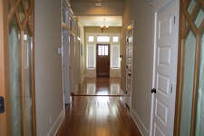 Original wood floors were restored in Cody Doege's remodeled Tobin Hill home, built in 1905.