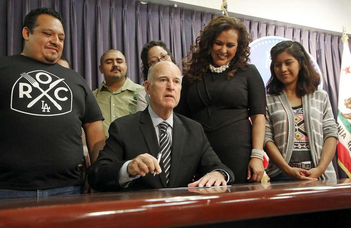 California Gov. Jerry Brown speaks at news conference after signing legislation to provide paid sick leave to millions of Californias.