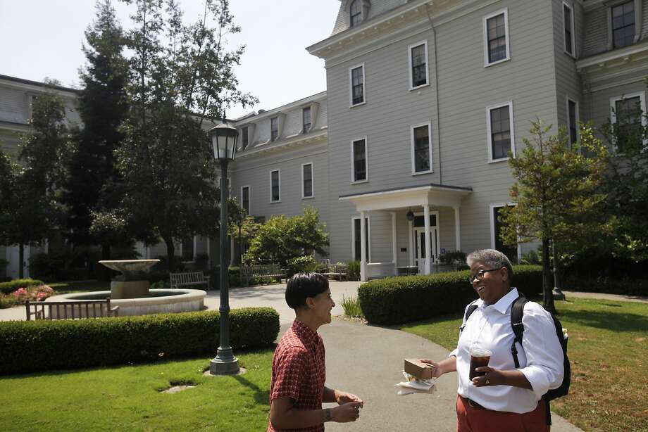 Gender-queer student Sonj Basha (left) chats with Professor Ajuan Mance last month at Mills College. Photo: Leah Millis, The Chronicle
