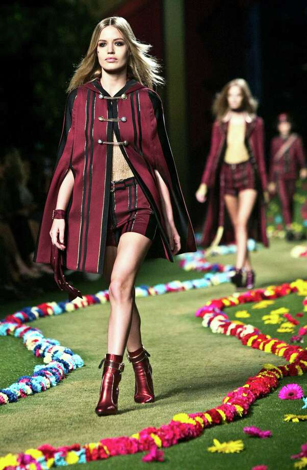 Tommy Hilfiger sent '60s and '70s rock-inspired  styles down the runway, including a look that channeled the Beatles' Sgt. Pepper. Photo: Bebeto Matthews, STF / AP