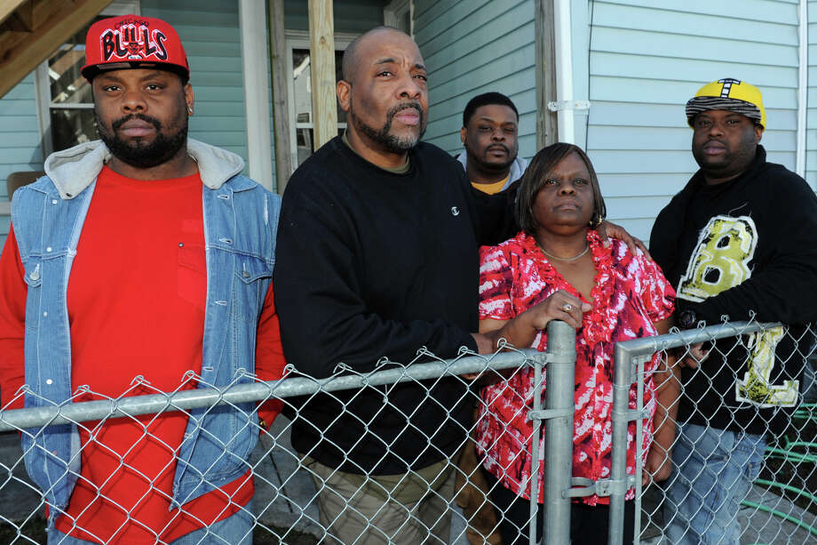 Horace and Margaret Jennings stand with their three sons, (l-r) Eric, Dennis and Bernard outside their house on Pleasant Street, in Bridgeport, Conn., Jan. 31st, 2013. The Jennings have filed a complaint following an incident last week when Horace Jennings was tasered by Bridgeport Police officers outside the family home. All five of the Jennings were arrested during the incident. Photo: Ned Gerard / Connecticut Post