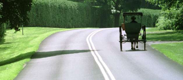 Times Union Photo by Skip Dickstein -- A horse and buggy moves casually down Nelson Avenue south of the Saratoga Race Course in Saratoga New York July 27th 1999. Photo: SKIP DICKSTEIN / ALBANY TIMES UNION