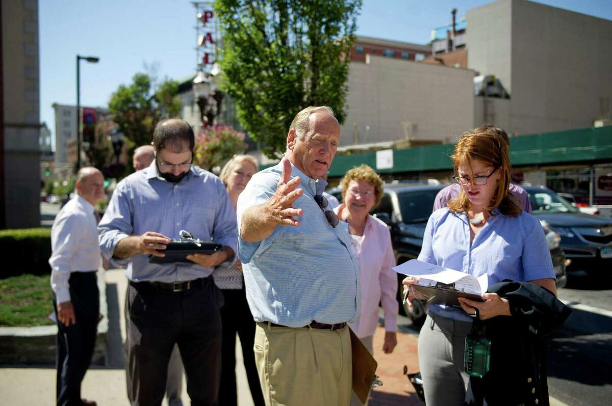 Robert Karp, center, and Emily Provonsha, right, participate in a walking tour of downtown Stamford as part of the Stamford Street Smart Initiative on Wednesday, September 10, 2014.