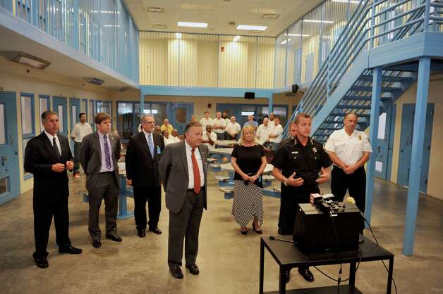 Jack Downing, foreground left, president and CEO of Soldier On and Albany County Sheriff Craig Apple, foreground right, along with other officials take part in a press conference at the Albany County Correctional Facility on Wednesday, Sept. 10, 2014, in Colonie, N.Y.  The event was held to announce a new program at the jail in a partnership with the Soldier On organization to provide incarcerated veterans services with the goal of fully reintegrating them back into the community.  (Paul Buckowski / Times Union) Photo: Paul Buckowski / 00028542A