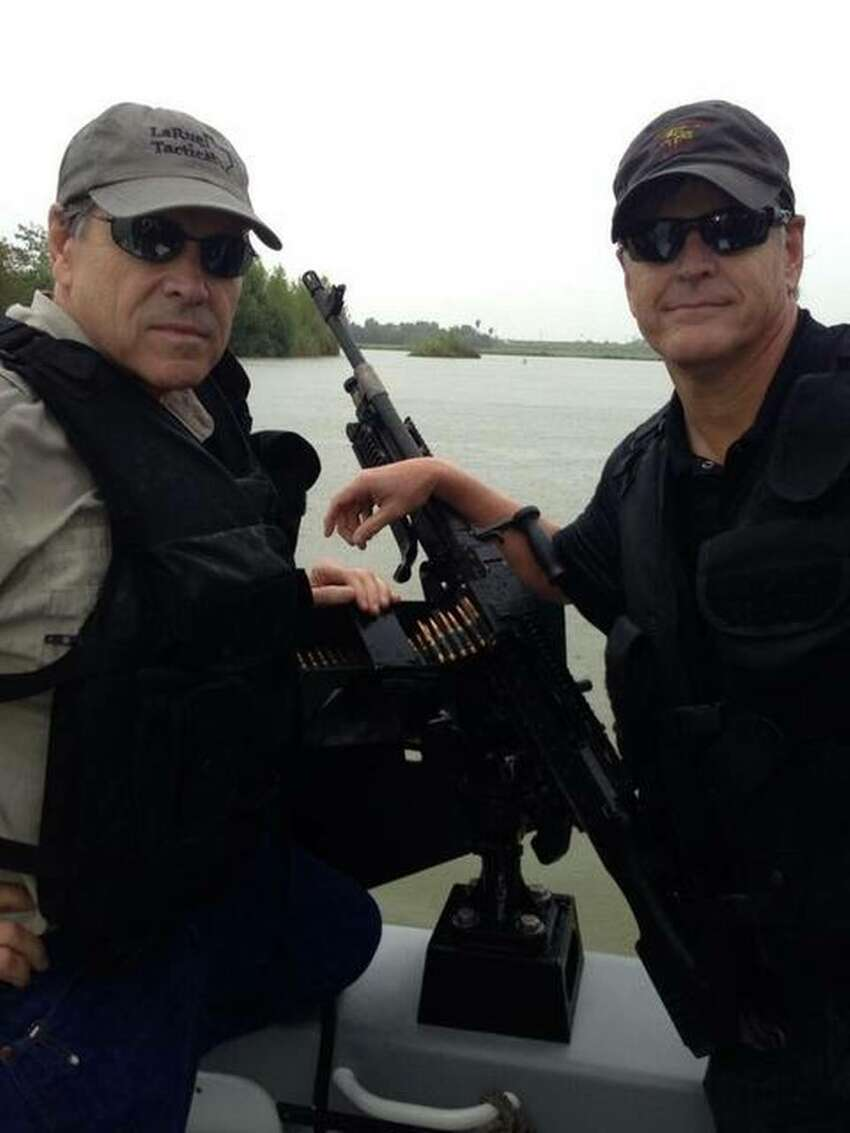 Gov. Rick Perry (left) poses for a photo op on a Department of Public Safety gun boat with Fox News host Sean Hannity during a July 2014 trip to the border.