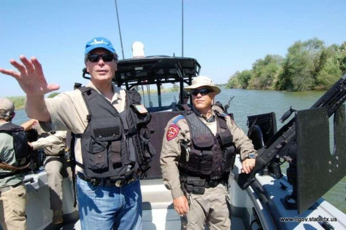 Lt. Gov. David Dewhurst talks to DPS agents on a gun boat in the Rio Grande.