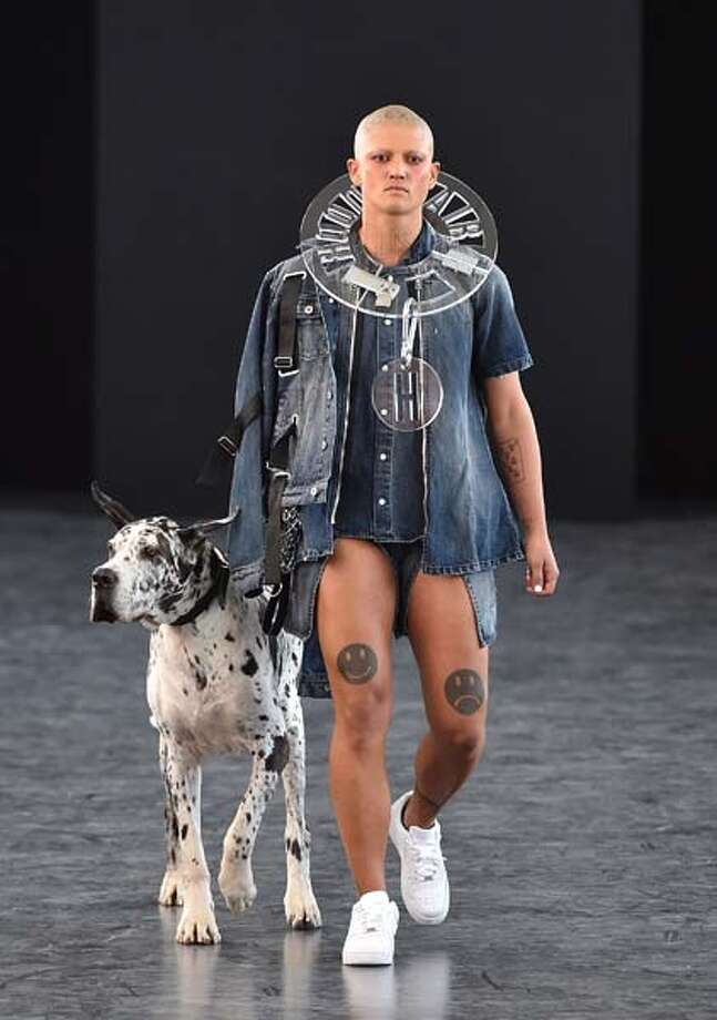 There are so many happy things in this ensemble. Cute dog, large plastic necklace, lack of pants. Why, then, is the left knee so darn sad? Photo: Slaven Vlasic, Getty Images / 2014 Getty Images