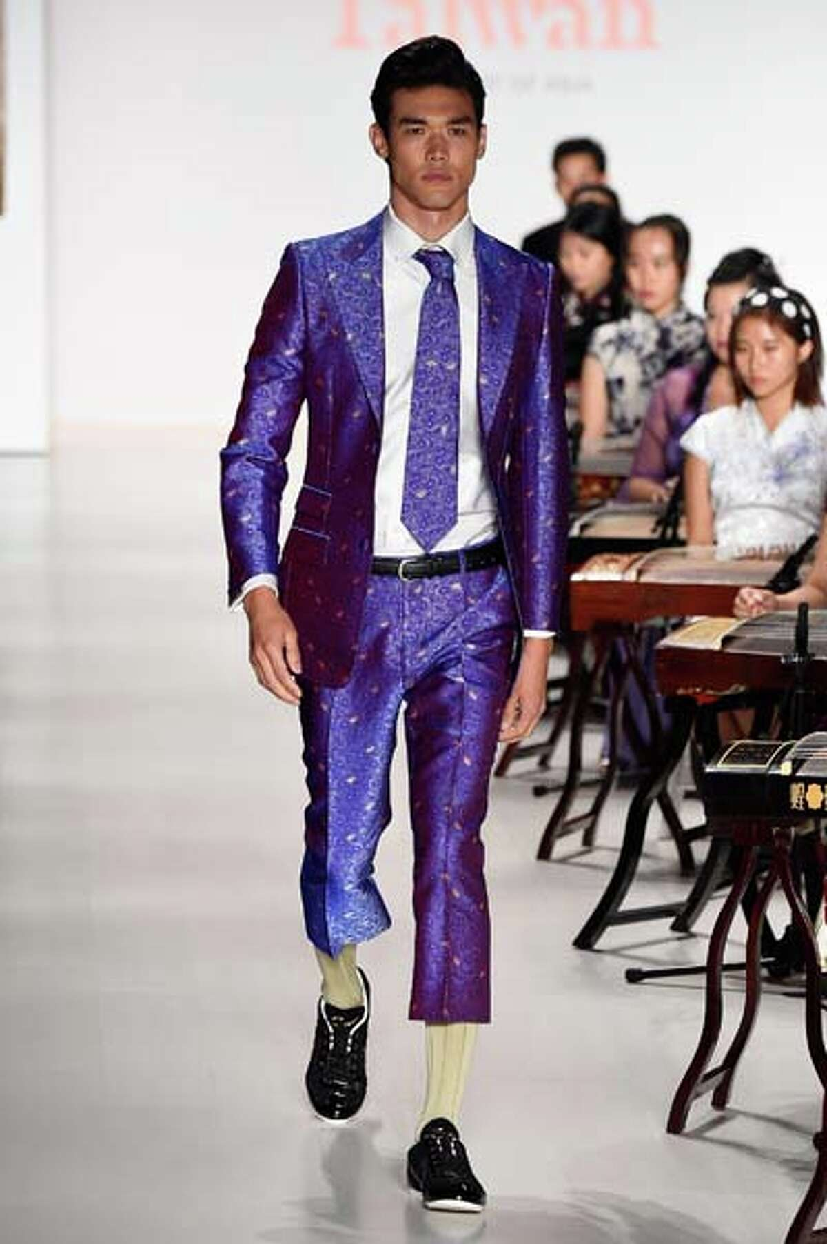 Purple glitter fabric, matching tie, comically short pants. If men became evil bridezillas, this is what they would make their frenemy bridesmaids wear.