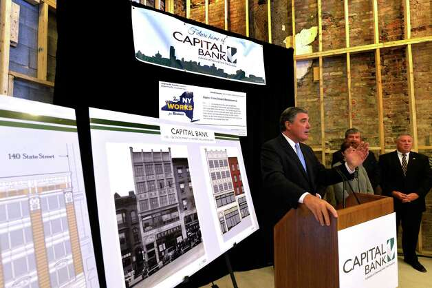 Ronald M. Bentley, president and CEO of Chemung Canal Trust Co., which oversees Capital Bank, addresses media and interested parties during a gathering to announce the tenancy of Capital Bank at the renovated 132 State Street  property Wednesday morning, Sept. 10, 2014, in Albany, N.Y.    (Skip Dickstein/Times Union) Photo: SKIP DICKSTEIN / 00028446A