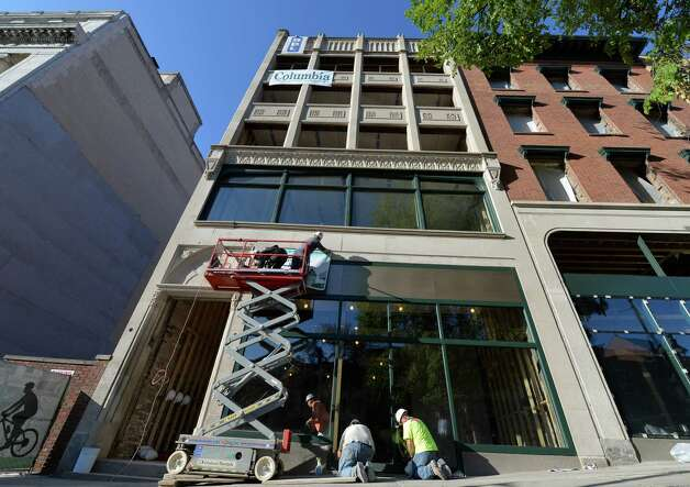 Workers put the finishing touches on the exterior of 132 State Street  Wednesday morning, Sept. 10, 2014, in Albany, N.Y. The building will house  Capital Bank.    (Skip Dickstein/Times Union) Photo: SKIP DICKSTEIN / 00028446A