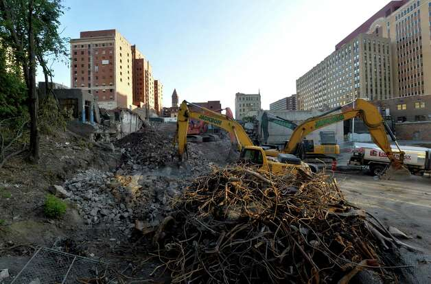 Demolition work continues on the Wellington Row on Eagle Street  Wednesday morning Sept. 10, 2014 in Albany, N.Y.    (Skip Dickstein/Times Union) Photo: SKIP DICKSTEIN / 00028445A