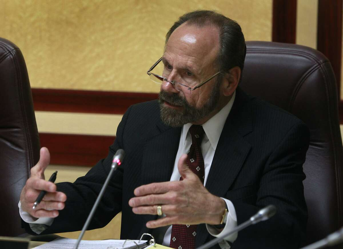 Sen. Jerry Hill, who sits on the Energy, Utilities and Communications committee, questions California Public Utilities Commission president Michael Peevey about the shooting incident at the Metcalf power plant, at the State Capitol in Sacramento, Calif. on Tuesday, March 18, 2014.