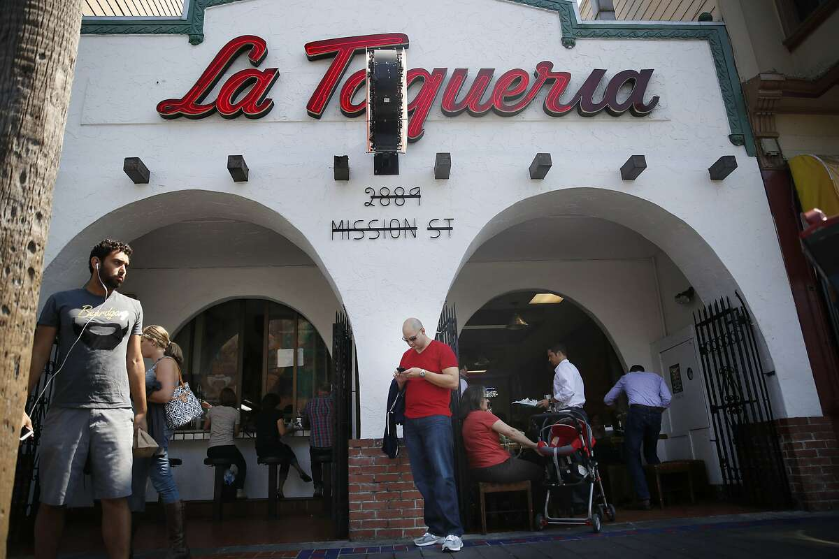 Matt Seiter, of Charlotte, North Carolina, checks his phone as he and his wife Courtney Seiter (partially seen second from left) leave La Taqueria on Wednesday, September 10, 2014 in San Francisco, Calif. The Seiters had read the burrito review of Anna Maria Barry-Jester, FiveThirtyEight's burrito correspondent, and came to La Taqueria to try the food.