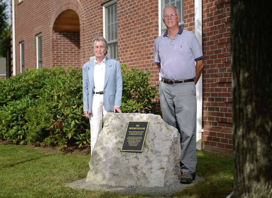 Kent Selectman Susi Williams and First Selectman Bruce Adams pose beside the new 9/11 memorial outside of the town hall in Kent, Conn. Wednesday, Sept. 10, 2014.  The memorial is dedicated to the 2,997 individuals who lost their lives during the 2001 terrorist attacks on the World Trade Center buildings in New York, including 23-year-old Kent resident James Gadiel. Photo: Tyler Sizemore / The News-Times