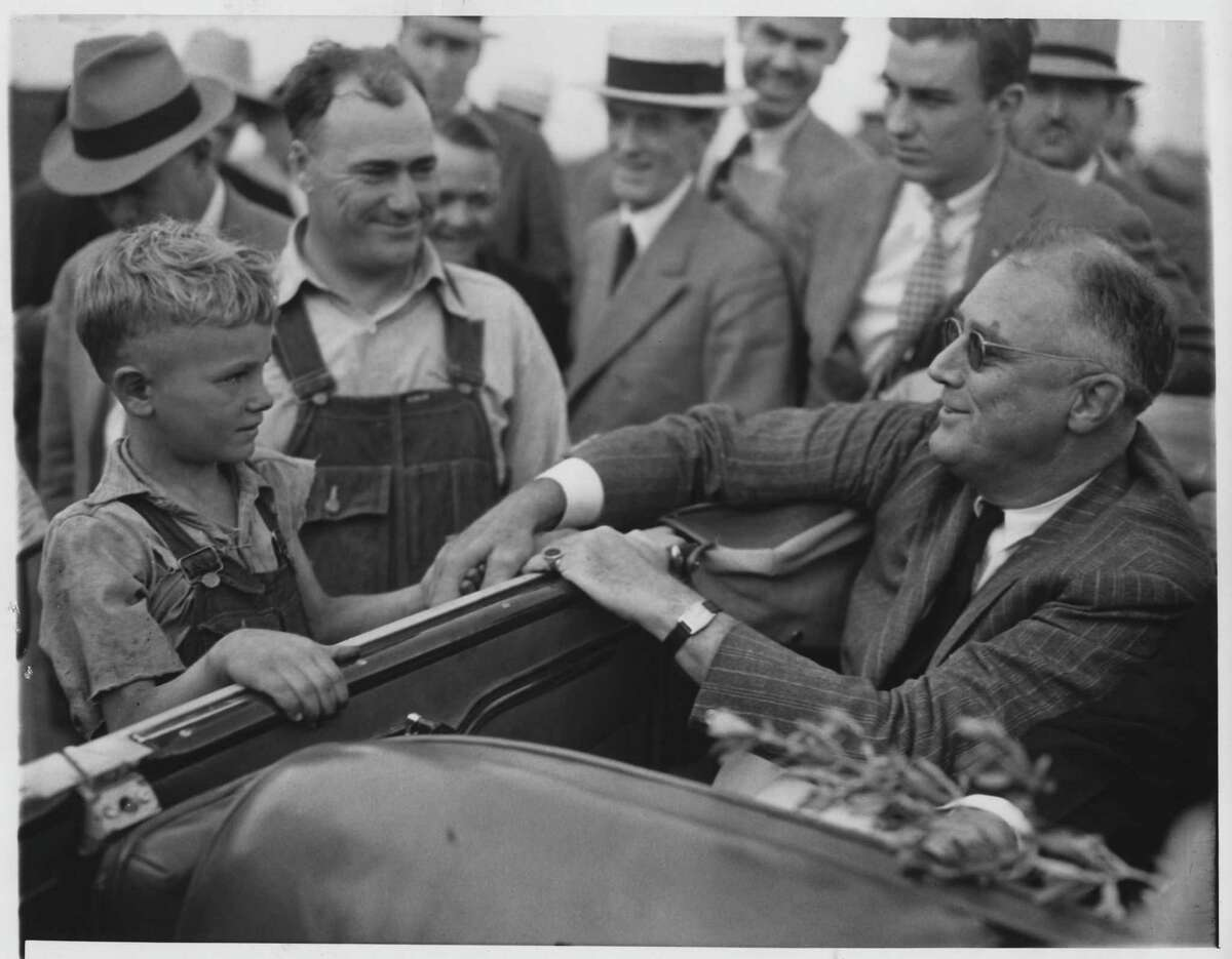 President Franklin Delano Roosevelt greets drought-stricken farmers in North Dakota, 1936.
