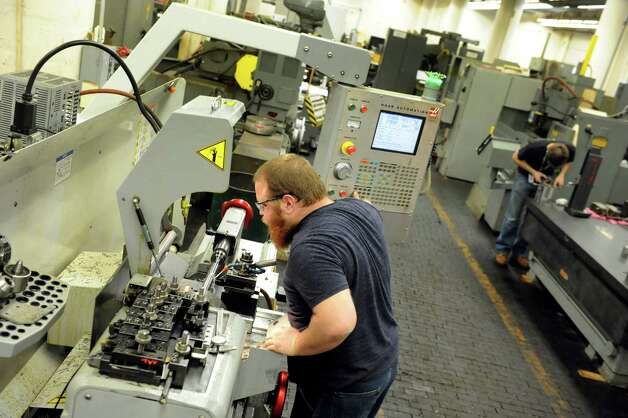 Nathan Coryea, left, and Colin McCarthy, both machinist apprentice from Hudson Valley Community College, work in the production building on Thursday, Jan. 16, 2014, at Watervliet Arsenal in Watervliet, N.Y. (Cindy Schultz / Times Union) Photo: Cindy Schultz / 00025387A