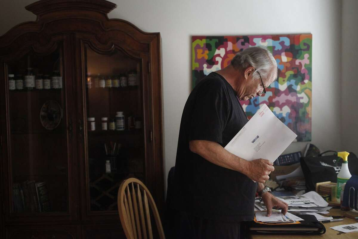 Barry Melton goes through mail in his Sacramento home. The veteran musician is a lawyer in Lake County.