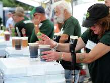 Sharon Lawless of Milford, right, pours Guinness at the annual Milford Irish Festival. This year's festival will be Friday, Sept. 19 and Saturday, Sept. 20.