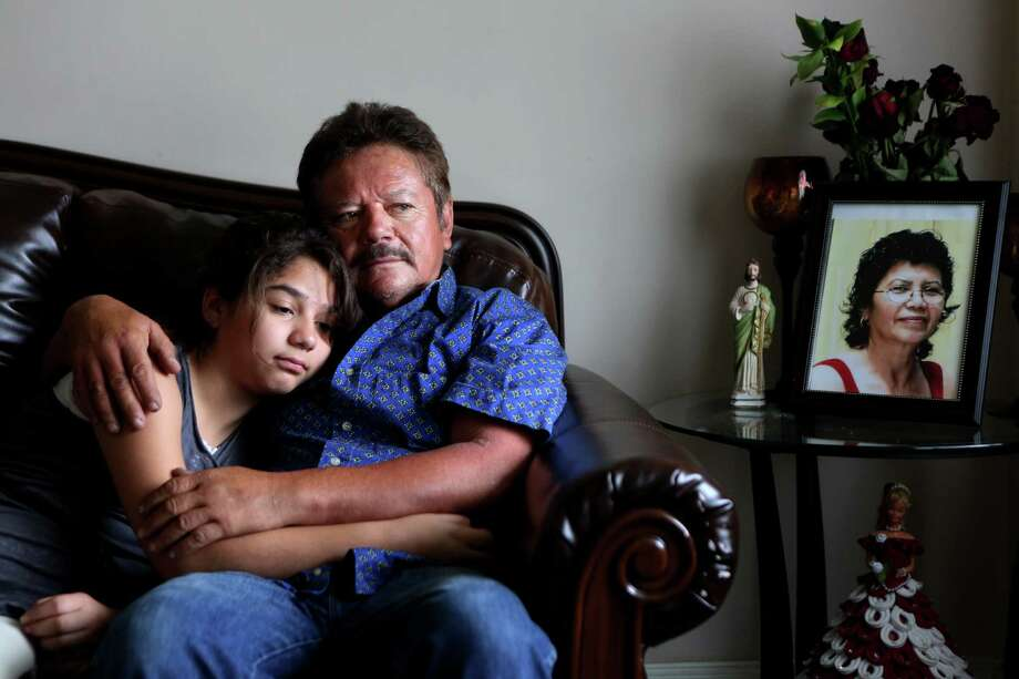 Guillermo Gomez, husband of Vilma Marenco, embraces daughter, Lupita Gomez, in their home in northeast Houston.  Guillermo called his wife over 25 times and was waiting for her to come home to say goodbye before heading out to a work trip to New Orleans on July 15, 2014, in Houston, Tx. Vilma Marenco was driving home after her lunch shift at Papasitos, when an oilfield hauling truck loaded with heavy pipe ran a red light and crushed the passenger side of the Chevy Cavalier Vilma Marenco was driving. The driver had no insurance. Photo: Mayra Beltran, Houston Chronicle / © 2014 Houston Chronicle