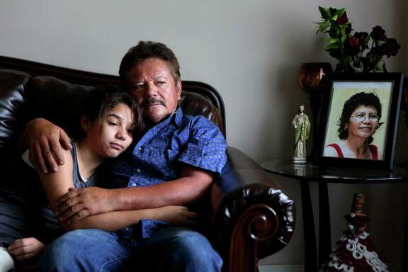*** LISE OLSON STORY TO BE PUBLISHED IN SEPTEMBER ***  Guillermo Gomez, husband of Vilma Marenco, embraces daughter, Lupita Gomez, in their home in northeast Houston.  Guillermo called his wife over 25 times and was waiting for her to come home to say goodbye before heading out to a work trip to New Orleans on July 15, 2014, in Houston, Tx. Vilma Marenco was driving home after her lunch shift at Papasitos, when an oilfield hauling truck loaded with heavy pipe ran a red light and crushed the passenger side of the Chevy Cavalier Vilma Marenco was driving. The driver had no insurance.