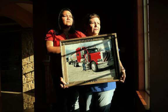 *** LISE OLSON STORY TO BE PUBLISHED IN SEPTEMBER ***  Frances Quintanilla and mother Rebecca Quintanilla hold a photograph of deceased family member, Guadalupe Quintanilla, who was killed in a head-on collision caused by a commercial driver who was dispatched to the Eagle Ford in a truck with bald tires on May 28, 2014, in Harligen, Tx. The two drivers lost their lives in the accident when the commercial driver lost control of his truck. The Quintanilla family filed a wrongful death lawsuit against Turn Around Trucking, who copied and pasted a safety manual from a Houston based hauling company and handed it to drivers.