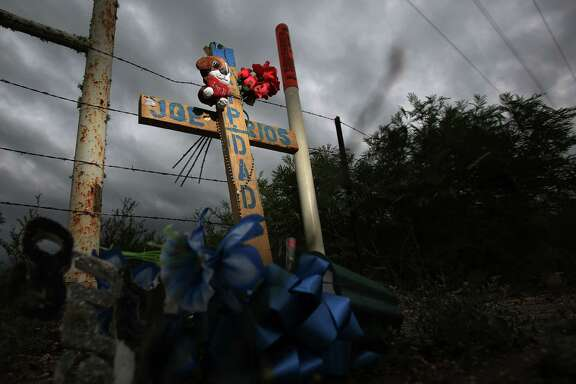 A cross dedicated to oil field worker Joe Rios marks the location outside Long Vista RV Park where a van carrying oil field workers collided with a school bus along Highway 72 on Jan. 30, 2014, in Three Rivers. There was three oilfield workers who died, and no students were injured.