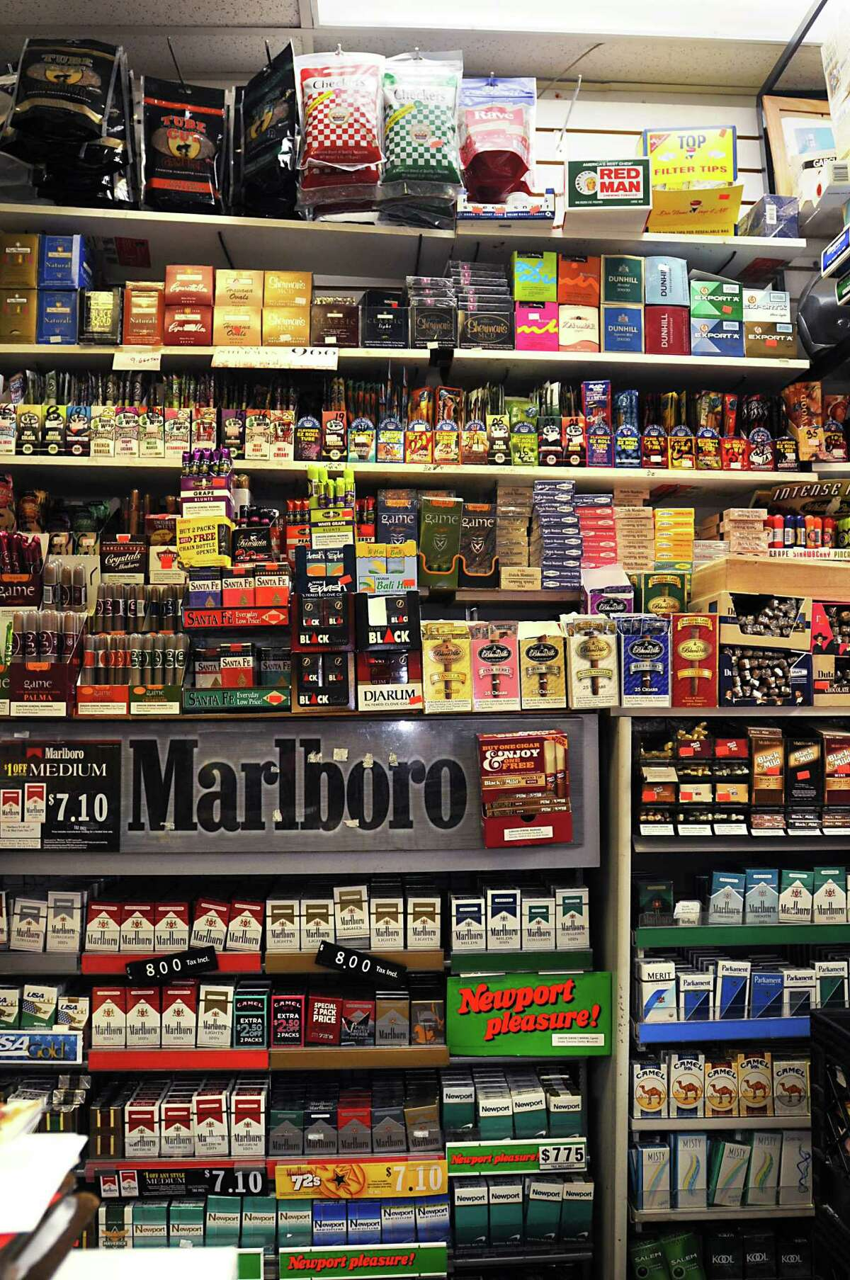 Shelves of tobacco products behind the front counter at Easha Convenience store Nov. 4, 2009, in Albany, N.Y. (Lori Van Buren / Times Union archive)
