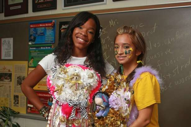 (For the Chronicle/Gary Fountain, October 9, 2009) Keneshia Colwell, left, and Melissa Dominguez, both 17, and seniors at Klein Forest High School, wearing their homecoming mums.