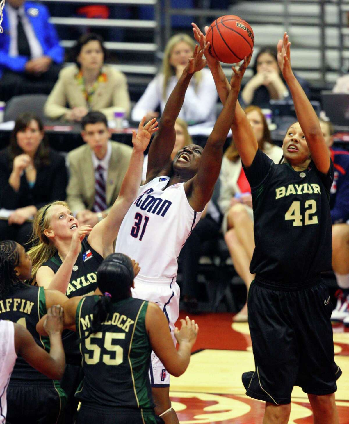 UConn's Tina Charles grabs a rebound while surrounded by four Baylor players, including Brittney Griner, during the Huskies semifinal game in the NCAA Women's Final Four at the Alamodome on April 4, 2010, against the Bears.