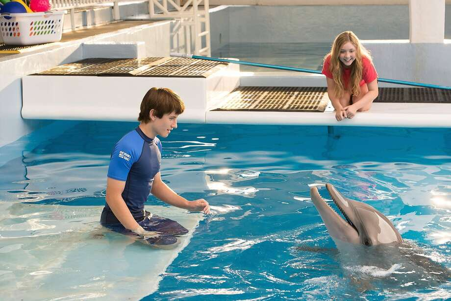 """Nathan Gamble, Cozi Zuehlsdorff and Winter the dolphin all reprise their roles from """"Dolphin Tale."""" The two teens have a nice chemistry, and the film does a good job exploring their relationships with the adults. Photo: Wilson Webb, McClatchy-Tribune News Service"""