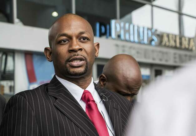 Rev. Markel Hutchins listens to a reporter's question in front of Philips Arena in Atlanta Monday, Sept. 8, 2014. Civil rights leaders in Atlanta say they will ask for a meeting with Atlanta Hawks officials after the disclosure of a racially charged email written by the basketball team's co-owner. Hutchins said that he would ask for a meeting to discuss what he believes is a racist attitude permeating the organization.  (AP Photo/Ron Harris)  ORG XMIT: GARH102 Photo: Ron Harris / AP