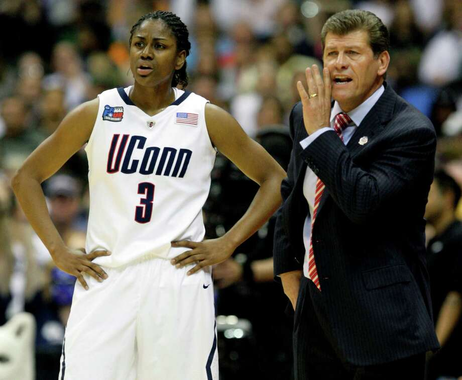 UConn coach Geno Auriemma talks to his players during their semi-final game in the NCAA Women's Final Four at the Alamodome in San Antonio, Texas Sunday night April 4, 2010 against Baylor while Tiffany Hayes stands next to him. Photo: Jerry Lara, San Antonio Express-News / © 2010 SAN ANTONIO EXPRESS-NEWS