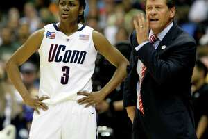 UConn coach Geno Auriemma talks to his players during their semi-final game in the NCAA Women's Final Four at the Alamodome in San Antonio, Texas Sunday night April 4, 2010 against Baylor while Tiffany Hayes stands next to him.