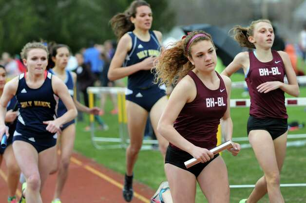 Burnt Hills' Dani Martino, second from right, runs with the baton from Emily Digman, right, in the 4-by-8 relay during a track meet on Saturday, May 3, 2014, at Colonie High School in Colonie, N.Y. (Cindy Schultz / Times Union) Photo: Cindy Schultz / 00026715A