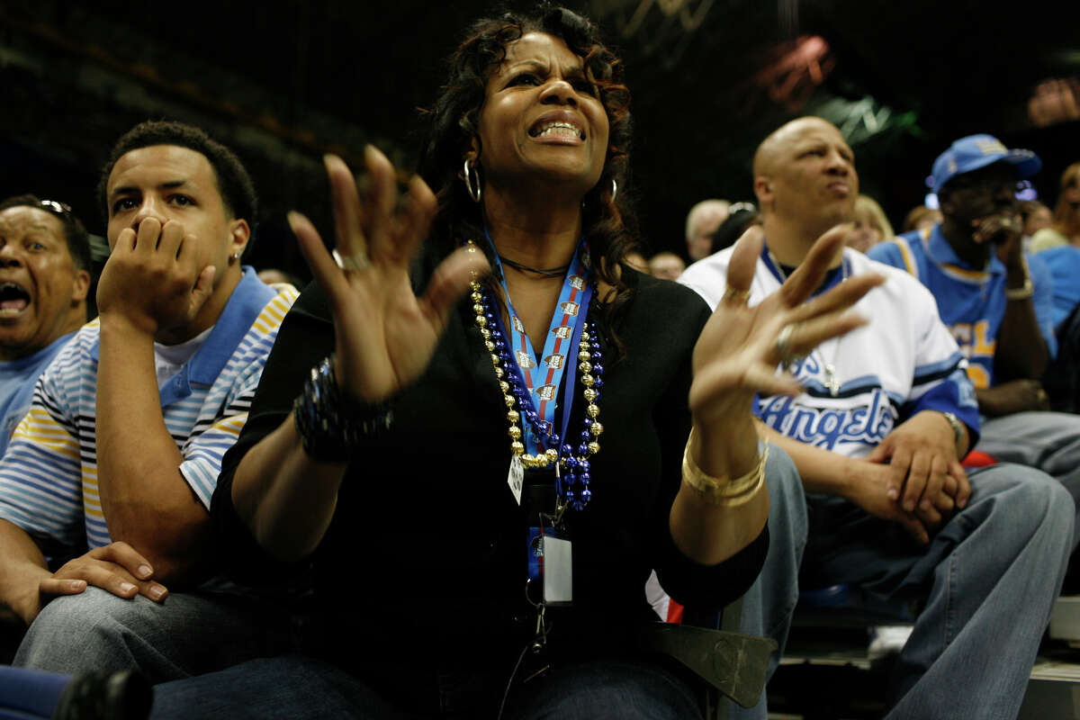 Debbie Shipp, the mother of UCLA player Josh Shipp, center, shows her frustration next to Shipp's brother, Jerren Shipp, left, and his uncle Ron Shipp, far left, as Memphis leads UCLA in Game One of the Final Four in San Antonio on Saturday April 5, 2008.