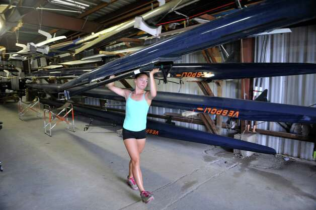 Meghan Gutknecht, 17, a rower with the Albany Rowing Center, carries a rowing shell out to the Hudson River on Thursday, Aug. 21, 2014, in Albany, N.Y.  (Paul Buckowski / Times Union) Photo: Paul Buckowski / 00028268A