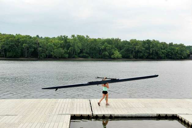 Meghan Gutknecht, 17, a rower with the Albany Rowing Center, places a rowing shell into the Hudson River on Thursday, Aug. 21, 2014, in Albany, N.Y.  (Paul Buckowski / Times Union) Photo: Paul Buckowski / 00028268A