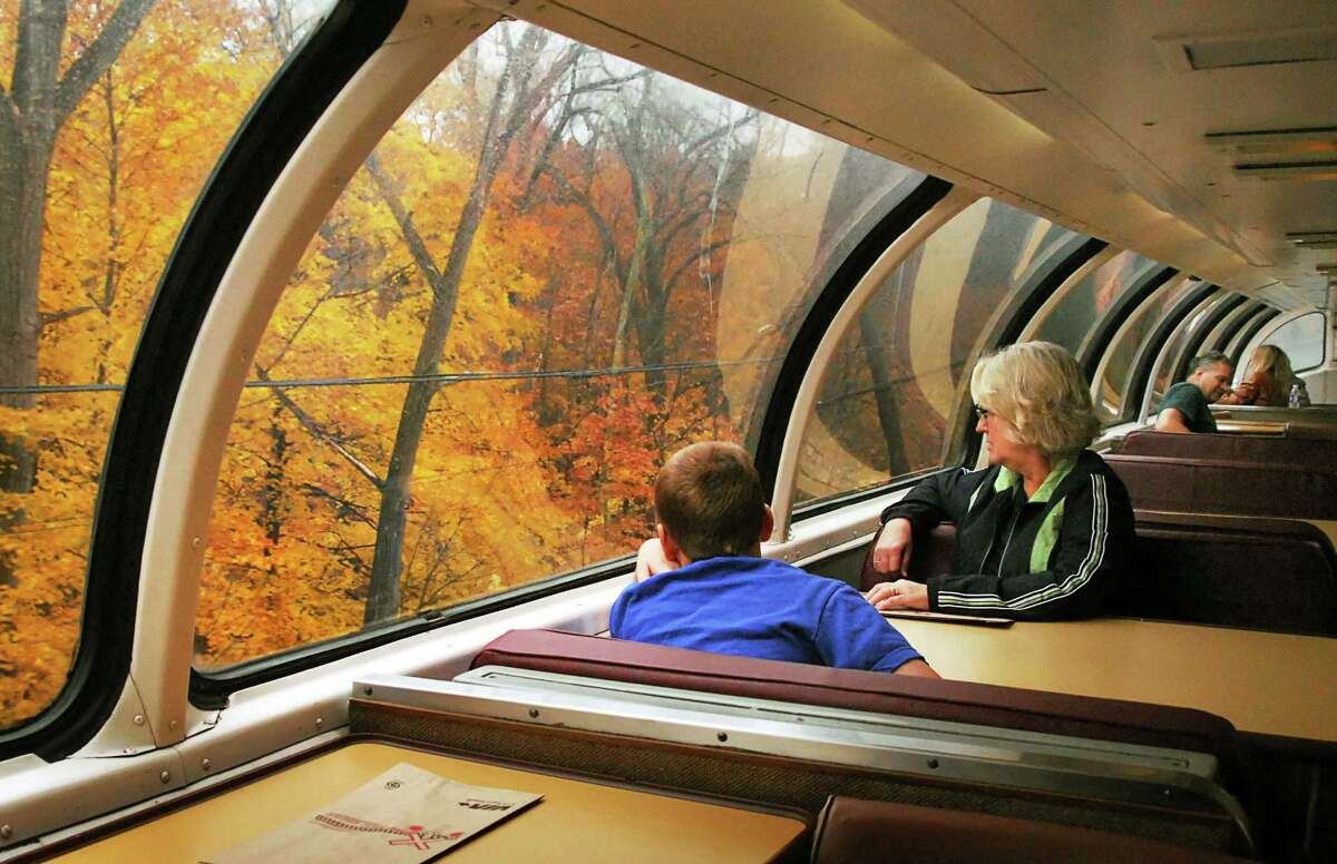 """10-year-old Cameron Midgett, left, and his grandmother Ellen Dawson, both of Sewell, NJ, look at fall foliage as they ride the historic """"Great Dome Car,"""" which has been temporarily added to Amtrak's Adirondack service this fall between Albany and Montreal, Thursday November 6, 2008."""