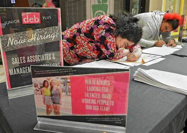 Vandana Vembar of Albany, left, and Ebony Govan of Albany fill out an applications for the junior deb plus store at Crossgates Mall during the mall's job fair for the holiday shopping season on Wednesday, Sept. 10, 2014 in Guilderland N.Y. (Lori Van Buren / Times Union) Photo: Lori Van Buren / 00028548A