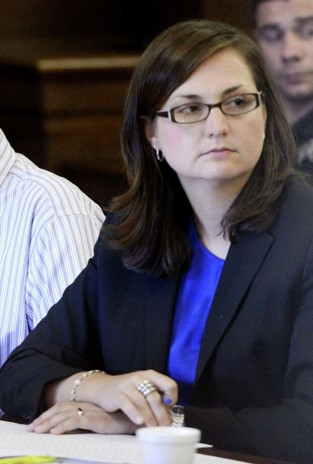 Sarah Burger, right, listens to opening arguments in the Crosier murder case in Rensselaer County Courthouse in Troy, N.Y. July 12, 2012. (Skip Dickstein / Times Union archive) Photo: SKIP DICKSTEIN
