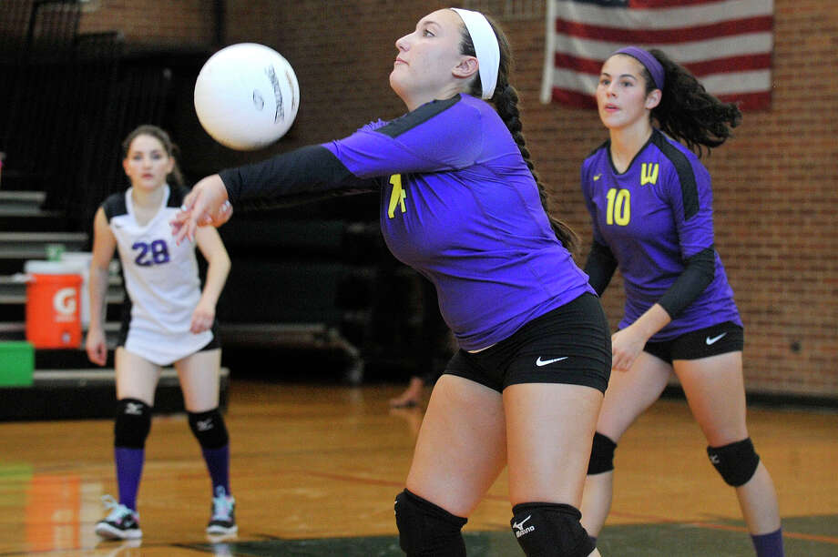 Westhill's Jessica Mezias connects with the ball during the Vikings' volleyball match against Trinity Catholic at Trinity Catholic High School in Stamford, Conn., on Wednesday, Sept. 10, 2014. Westhill won, 3-1. Photo: Jason Rearick / Stamford Advocate